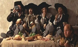 Oliver Reed as Athos, Frank Finlay as Porthos, Richard Chamberlain as Aramis, Michael York as d'Artagnan, and Roy Kinnear as Planchet