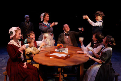david pichette as scrooge looks on as the cratchit family celebrates christmas the act theater