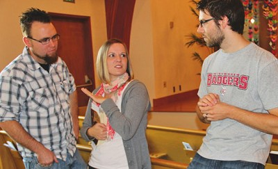<p><strong>Stephen Gumber (left), Rachael Gumber and Nathan Sweet talking in the sanctuary after Sunday services at Queen Anne Community Church. Photo by Gwen Davis</strong></p>