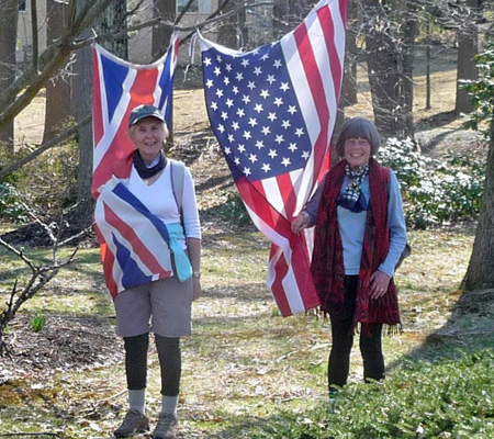 Marjorie Clasper (left) from Windsor, England, and Kathy Biever from Queen Anne pose with their respective country's flags. Photo courtesy of Kathy Beiver