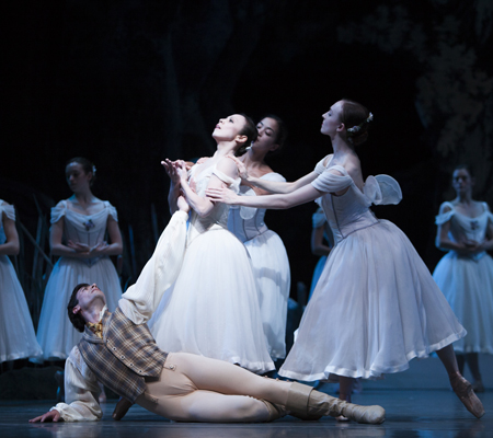 "Pacific Northwest Ballet soloist Jerome Tisserand as Albrecht, principal dancer Kaori Nakamura as Giselle and company dancers as the ghostly Wilis in Peter Boal's staging of ""Giselle,"" which runs through Sunday, June 8. Photo by Angela Sterling"