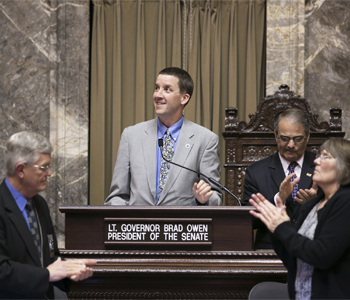 The Washington state Senate applauds state Teacher of the Year Lyon Terry. Photo courtesy of Washington State Legislative Support Services