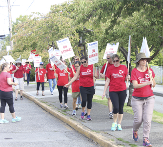 Striking teachers march outside Lawton Elementary Schools in Magnolia on Wednesday, Sept. 9, on what would have been the first day of classes in Seattle Public Schools. Photo by Joe Veyera