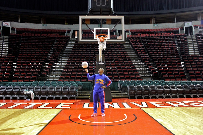 Buckets Blakes of the Harlem Globetrotters stands underneath a basket at KeyArena, in advance of the team's games in Western Washington this weekend. Photo by Joe Veyera