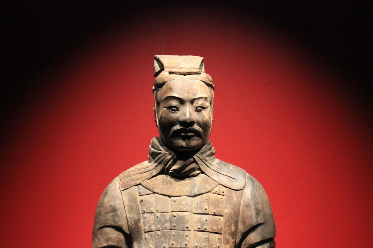 A life-sized, clay figure of an armored officer, dating back to the Qin Dynasty more than 2,200 years ago, stands at attention as part of the Terracotta Warriors of the First Emperor exhibit at the Pacific Science Center, which runs through Sept. 4. Photo by Joe Veyera