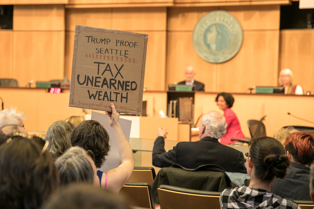 Supporters of an income tax on Seattle's wealthiest residents fill City Council chambers during a public hearing on the new tax June 14. Photo by Lizz Giordano