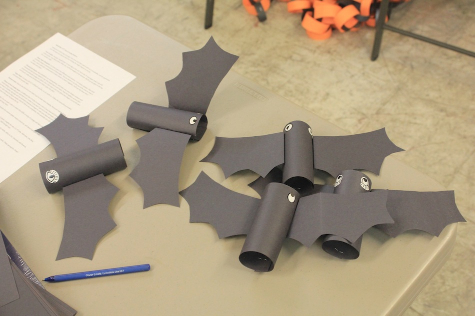 Bats made of cardboard tubes were among the many decorations that volunteers worked on. Photo by Joe Veyera
