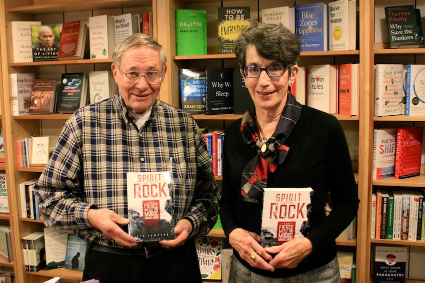 "Bill Stafford (left) and Carol Arnold pose with copies of, ""Spirit in the Rock,"" at Magnolia's Bookstore, where they held a talk and book signing in October. Photo by Joe Veyera"
