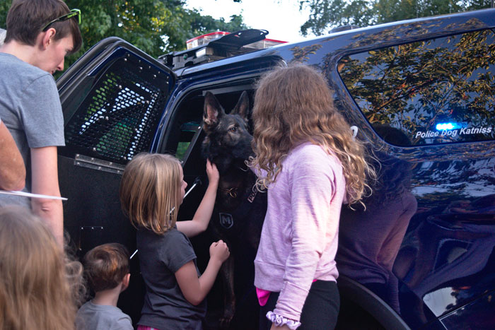 Photos by Hugh Garbrick: Kids line up at a National Night Out block party in Queen Anne to meet Seattle Police K-9 Katniss on Tuesday, Aug. 6.